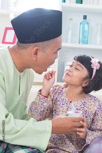 Southeast Asian father and daughter