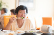 Senior Asian Woman eating vegetable
