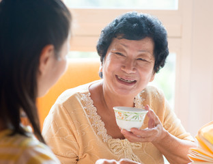 Asian Chinese family having breakfast