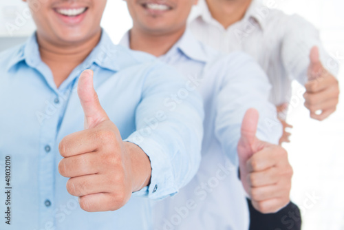 Thumbs up Southeast Asian business man