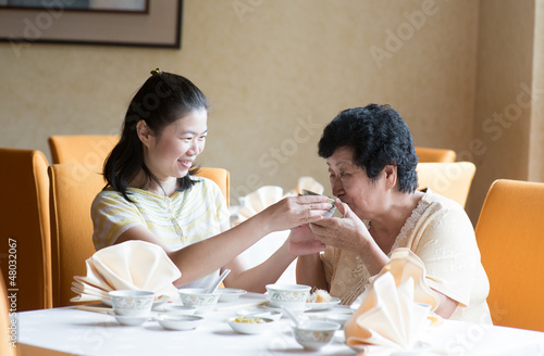 Asian Chinese family having meal