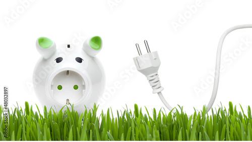 Leinwanddruck Bild Sparschweinchen mit Stromkabel