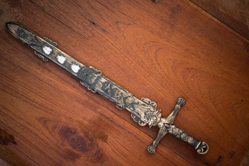 sword knight on wood texture