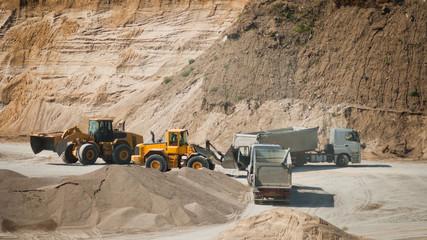 Machines working at gravel pit