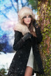 Winter Girl with beautiful make up,  and snow flake, forest back