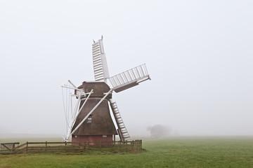 wooden windmill in fog