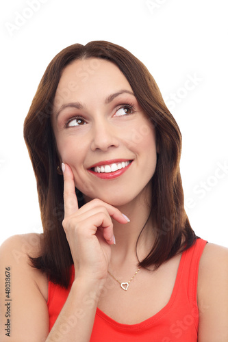 Woman thinking with finger on chin