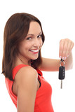 Smiling woman showing car key