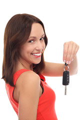 Smiling woman showing car key