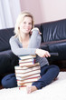 Blonde girl happily relaxing in the books.