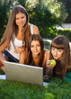 Happy young student girls outdoors