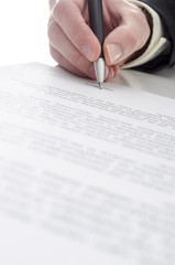 Businessman's hand signing a contract