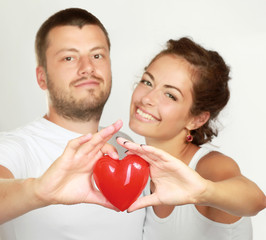 Couple holding red heart , isolated on white background