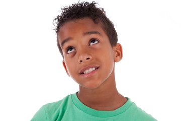 Portrait of a cute african american little boy looking up