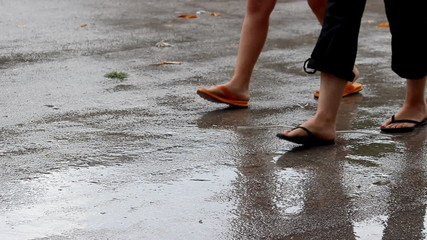 Girl and woman walking on summer rain