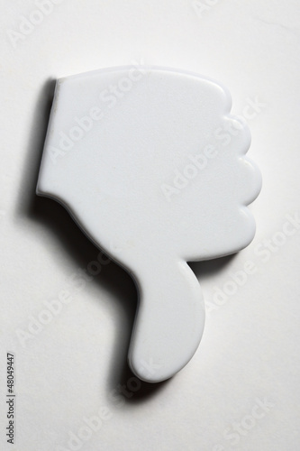 Thumb down negative sign badge