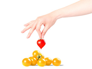 heart background with hand and sherry tomatoes