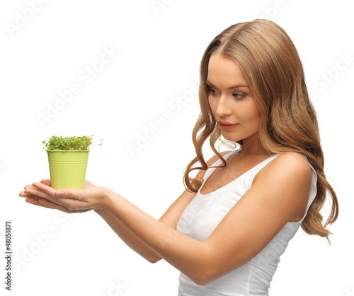 woman with green grass in pot