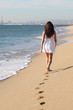 Beautiful woman walking on the beach