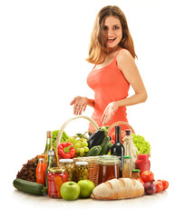 Young woman with variety of grocery products