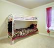 Kids bedroom with double bunk metal bed.