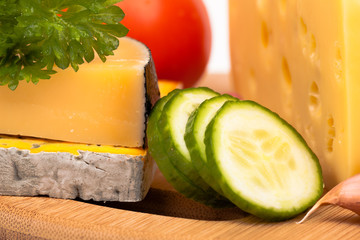 Various types of cheese and cucumber