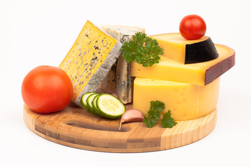 Various types of cheese on wooden plate isolated on white