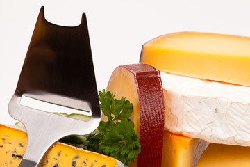Various types of cheese and knife isolated on white