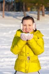 Girl holding snow