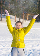 Girl throwing snow