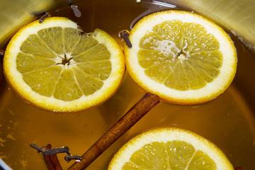 Boiling Apple Cider with Orange Slices