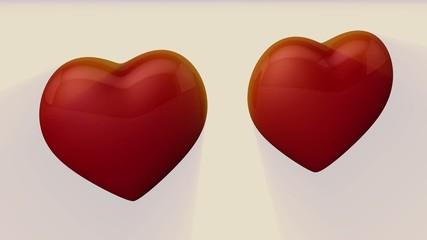 2 corazones 3d en movimiento