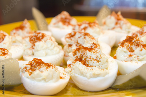 Plate of Deviled Eggs and Pickles Closeup