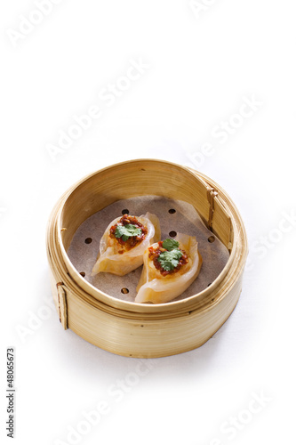dim sum in bamboo steam containers