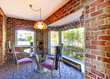 Breakfast table with brick walls and old carpet.