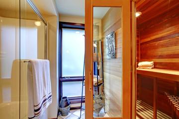 Home sauna interior with shower.