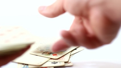 Playing cards in hand  on white background
