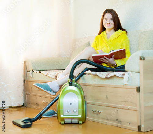 woman reposes from household chores