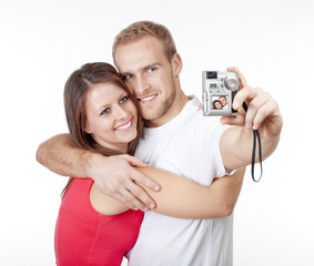 happy young couple taking pictures