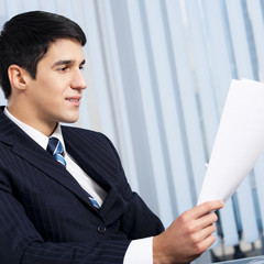 Businessman with document at office
