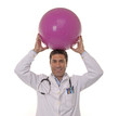 Portrait of happy doctor with a Pilates ball.
