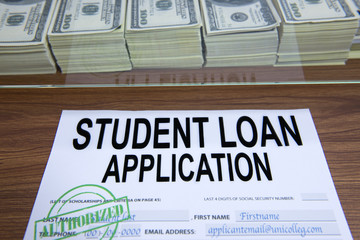 Approved student loan application and dollar bills