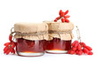 ripe barberries and jars of jam isolated white
