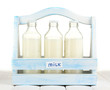 Milk in bottles in wooden box