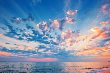 A beautiful sunset sky over the sea.