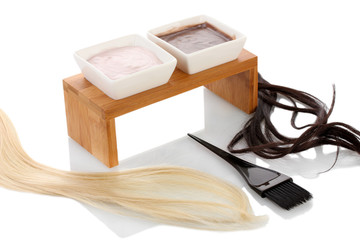 hair dye in bowls and brush for hair coloring,