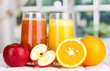 fresh fruit juices on wooden table, on window background
