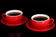 A red cups of strong coffee isolated on black