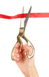 Cutting red ribbon isolated on white