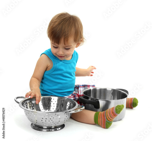 cute little boy with kitchen accessories, isolated on white